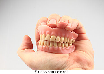 teeth prosthesis in the human hand