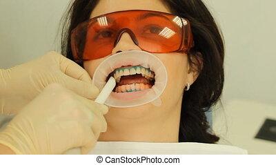 Teeth Whitening. Dental vacuum clea