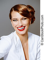 Close-up portrait of a beautiful smiling woman. Beauty, fashion. Make-up.