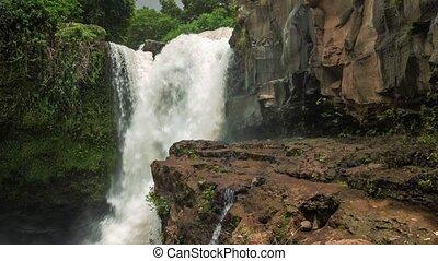 Tegenungan Waterfall near Ubud Bali. Waterfall hitting Water...