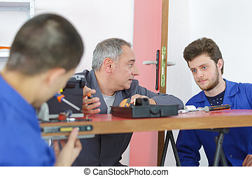 teh apprentices in the workshop