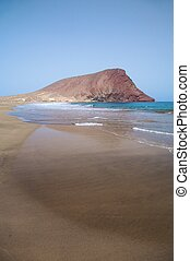 red mountain - tejita beach with the red mountain at ...