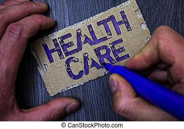 tekst, meldingsbord, het tonen, gezondheid, care., conceptueel, foto, medisch, onderhoud, verbetering, van, lichamelijk, geestelijk, condities, man, werkende , vasthouden, blauwe , teken, ideeën, boodschap, karton, houten, achtergrond.