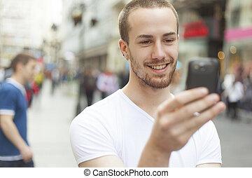 teléfono celular, ambulante, joven