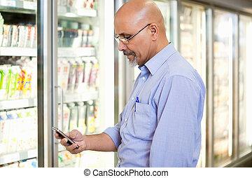 teléfono celular, lista de la tienda de comestibles