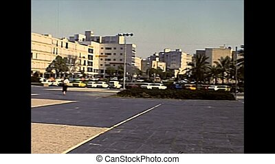Old Tel Aviv city square with cars parked. Historical archival footage in the 1970s of Israel.
