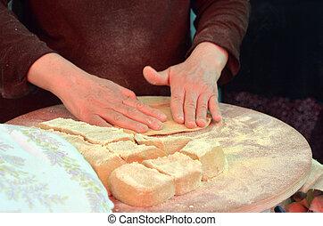 Taboon bread - TEL AVIV, ISR - APR 06 2015:Druze woman hands...