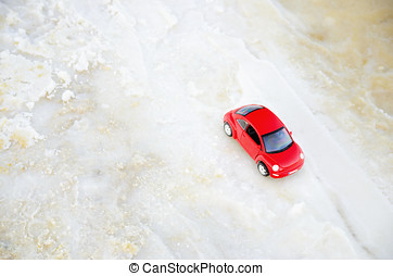 Tel Aviv, Israel - April 10, 2017: Red car miniature on the beach in soft focus