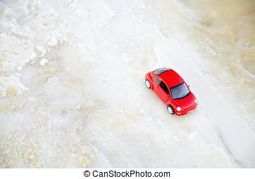 Tel Aviv, Israel - April 10, 2017: Red car miniature on the beach in soft focus