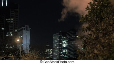 Tel Aviv night cityscape with condensing steam - Tel Aviv...