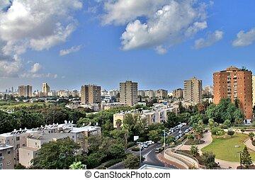 Tel Aviv on blue cloudy background