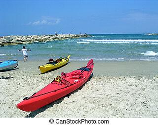 Red Kayak on the beach in Tel Aviv, Israel