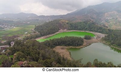 telaga warna lake at plateau dieng - volcanic sulfur lake...