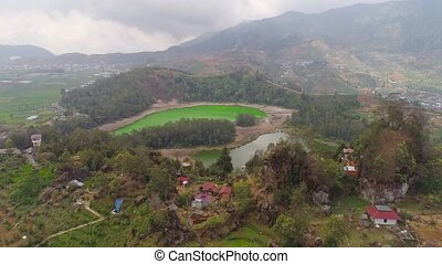 telaga warna lake at plateau dieng - volcanic sulfur lake...