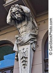 telamon's sculpture in the design of the building in Lviv, Ukraine