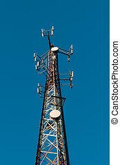 Telecom tower against a blue sky