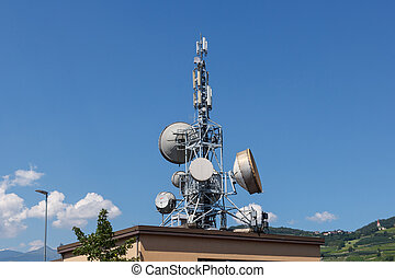 Telecommunication base stations on the roof of the building