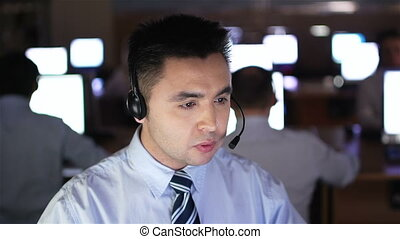 Telecommunication - Male operator consulting clients online...