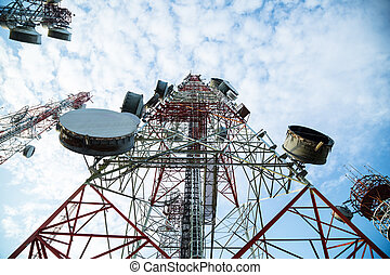 Telecommunication mast TV antennas with blue sky in the...