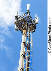 Telecommunication tower for mobile phone with antennas over a blue sky