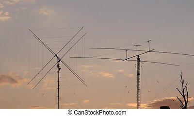 Telecommunication tower with a clouds. Used to transmit...