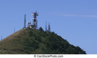 Telecommunication towers on top of a hill in Genoa, Italy