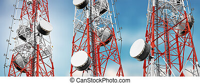 Telecommunication towers with TV antennas and satellite dish...
