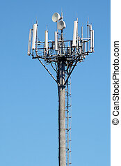 Telecommunications antenna on blue sky background