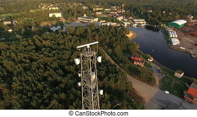 Telecommunications tower above town - HD -...