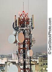 Telecommunications tower by night