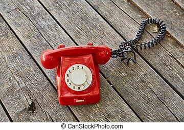 telefone velho, ligado, placas madeira