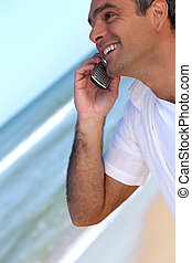 telefono mobile, sorridente, spiaggia, uomo