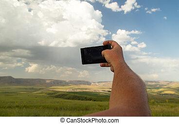 telefoon, in, overhandiig op, een, achtergrond, van, wolken