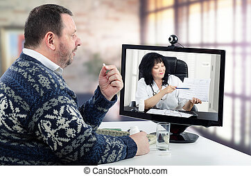 Bearded man in Scandinavian sweater takes pill during virtual doctor session. Middle-aged man suffers from high blood pressure.
