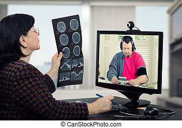 Telehealth doc takes patients blood pressure - Virtual...