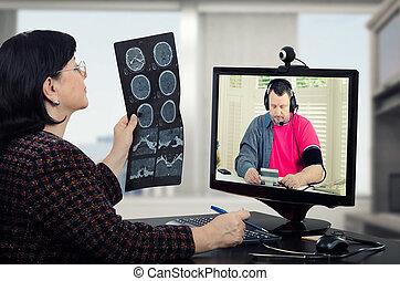 Telehealth doc takes patients blood pressure - Virtual...