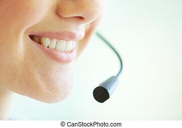 Telemarketing - Smiling telemarketing operator giving a...