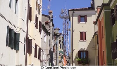 Telephone antenna in the middle of ancient houses