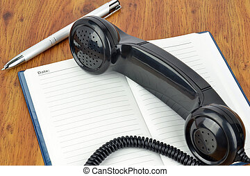 Telephone Appointment - A telephone handset lying on a...