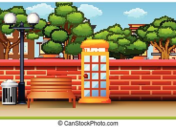 Telephone box in the city park background