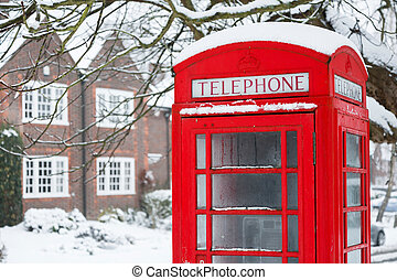 Telephone box with snow - Old English red phone box in...