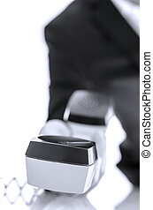 Telephone handset in businessman hand