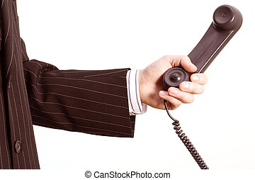 Telephone in a business hand