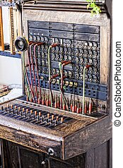 Vintage telephone operators board with wires and plugs