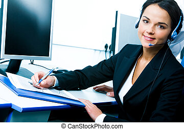 Telephone operator - Portrait of telephone operator sitting...