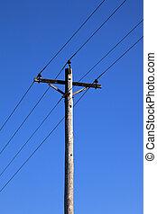 Telephone Pole shot against bright blue sky