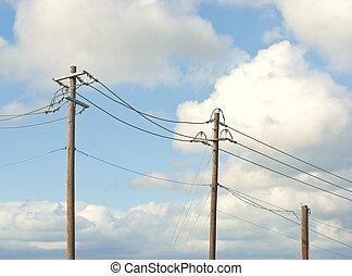 Telephone Poles - Row of telephone poles under a pretty blue...