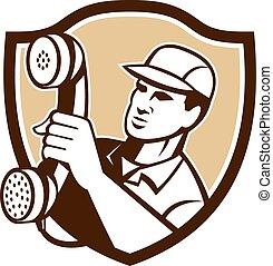 Telephone Repairman Holding Phone Shield