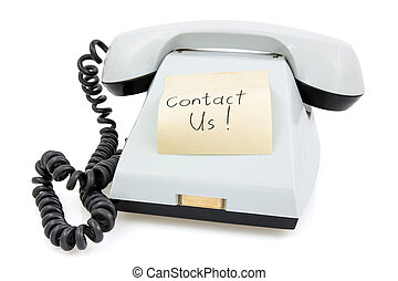 Telephone with sticky note Contact Us