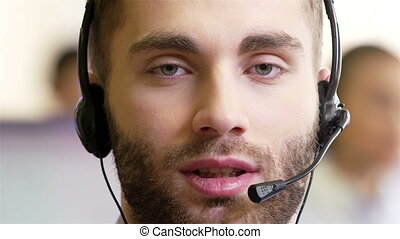 Telephonist - Help-desk assistant wearing headphones and...